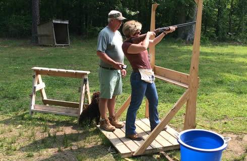 Nancy shooting Clays at Deep River.